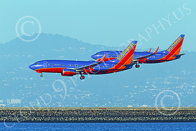 Boeing 737 00016 Two Boeing 737s Southwest Airline land simultaneously on SFO's parallel runways 12-2014 airliner picture by Peter J Mancus