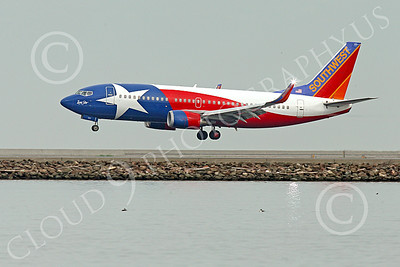 Boeing 737 00182 A colorful Southwest Airline Boeing 737 LONE STAR on final approach to land at SFO 12-2014 airliner picture by Peter J Mancus