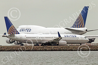 Boeing 737 00227 United Airline Boeing 737 N37437 is small compared to the Boeing 747 behind it at SFO 12-2014 airliner picture by Peter J Mancus