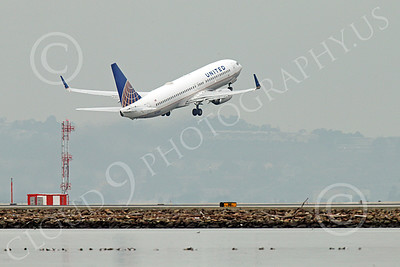 Boeing 737 00230 A United Airline Boeing 737 N27477 takes-off at SFO 12-2014 airliner picture by Peter J Mancus
