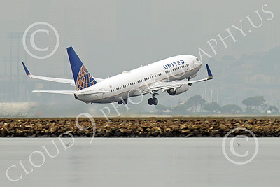 Boeing 737 00226 A United Airline Boeing 737 N27477 takes-off at SFO 12-2014 airliner picture by Peter J Mancus