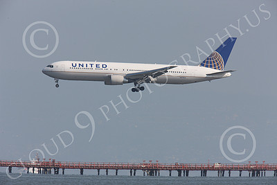 B767 00274 Left side view of United Airline Boeing 767, N    UA, landing over the bay at SFO, airliner picture, by Peter J Mancus