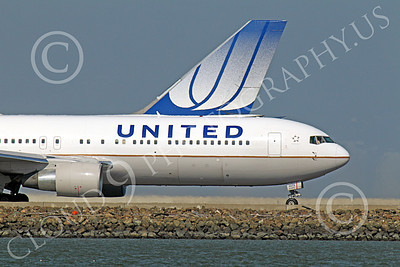 B767 00137 A United Airlines Boeing 767 taxing for take-off at SFO with an United Boeing 747 tail in the background, by Peter J Mancus