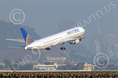 B767 00148 United Airlines Boeing 767 N675UA taking off at SFO with Transamerica building in city skyline in the background, by Peter J Mancus