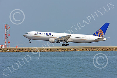 B767 00436 Quarter left rear view of United Airline Boeing 767, N673UA, landing at SFO, airliner picture, by Peter J Mancus