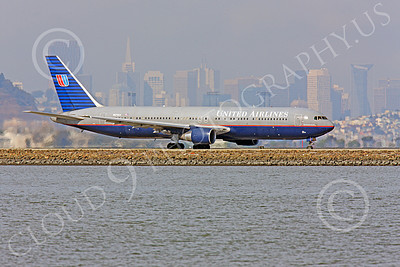B767 00499 United Airline Boeing 767, N676UA, taxing for take-off, at SFO, with San Francisco in the background, airliner picture, by Peter J Mancus