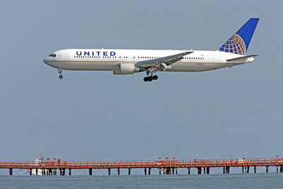 B767 00274 Left side view of United Airline Boeing 767, N673UA, landing over the bay at SFO, airliner picture, by Peter J Mancus