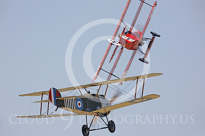 WWI-Sopwith Camel 00065 Sopwith Camel and Fokker DR1 Tri-Plane dogfight by Peter J Mancus