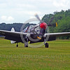 WB-Curtiss P-40 Warhawk 00033 A taxing on grass skull head marked Curtiss P-40 Warhawk USA WWII era fighter warbird picture by Stephen W  D  Wolf
