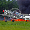 WB-Curtiss P-40 Warhawk 00131 A Curtiss P-40 Warhawk USA WWII era fighter taxis in front of a raging fire warbird picture by Stephen W  D  Wolf