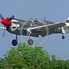 WB-Curtiss P-40 Warhawk 00102 A landing Curtiss P-40 Warhawk USA WWII era fighter warbird picture by Stephen W  D  Wolf