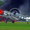 WB-Curtiss P-40 Warhawk 00007 A Curtiss P-40 Warhawk USA WWII era fighter taxis in front of a raging fire warbird picture by Stephen W  D  Wolf