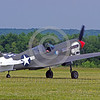 WB-Curtiss P-40 Warhawk 00157 A taxing skull head Curtiss P-40 Warhawk USA WWII era fighter warbird picture by Stephen W  D  Wolf