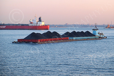 BARGE 00005 A barge loaded with coal under way in New York Harbor, by John G Lomba