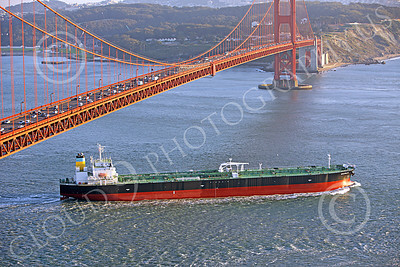 COTS 00056 A starboard elevated view of the massive Greek ocean tanker ship NEAPOLIS, as it sails under the Golden Gate Bridge and into the Pacific Ocean, by Peter J Mancus