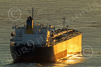 COTS 00074 A stern view of a massive Greek name civilian ocean tanker ship, bathed in golden twilight, as it leaves San Francisco Bay, by Peter J Mancus