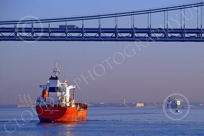 COTS 00011 Civilian oil tanker ship NORDIC HELSINKI sails under a bridge in New York harbor, by John G Lomba