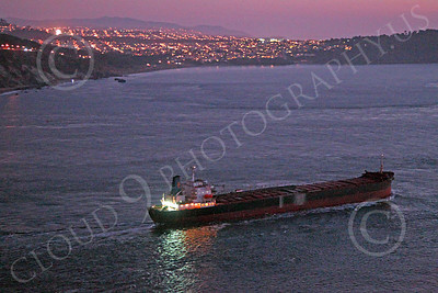COTS 00129 A night starboard view of a massive civilian ocean tanker ship seen leaving San Francisco Bay, by Peter J Mancus