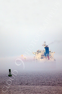 COTS 00021 A large civilian oil tanker ship sails through mist in New York harbor, by John G Lomba