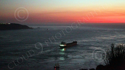 COTS 00075 An expansive view of the mouth of San Francisco Bay as a massive civilian ocean tanker ship sails for the open Pacific Ocean, at twilight, by Peter J Mancus
