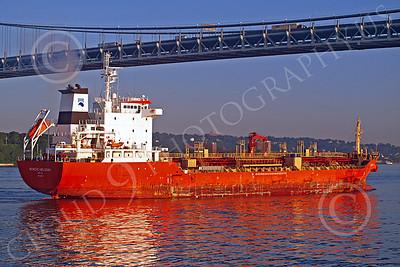 COTS 00017 Civilian oil tanker ship NORDIC HELSINKI sails under a bridge in New York harbor, by John G Lomba