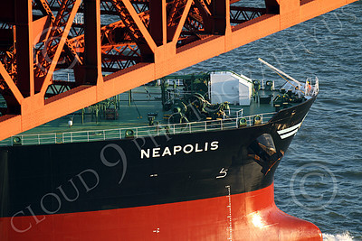 COTS 00132 A tight crop starboard bow view of the massive Greek ocean tanker ship NEAPOLIS as it sailed under the Golden Gate Bridge for a long journey across the Pacific Ocean, by Peter J Mancus
