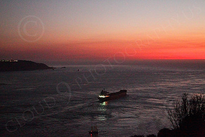 COTS 00053 An expansive view of the mouth of San Francisco Bay as a massive civilian ocean tanker ship sails for the open Pacific Ocean, at twilight, by Peter J Mancus