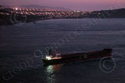 COTS 00059 A night starboard view of a massive civilian ocean tanker ship seen leaving San Francisco Bay, by Peter J Mancus