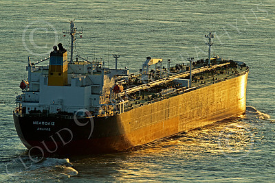 COTS 00135 A starboard quarter rear view of a massive Greek ocean going oil tanker ship bathed in golden twilight, by Peter J Mancus
