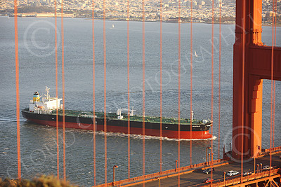 COTS 00150 The massive Greek ocean tanker ship NEAPOLIS, seen inside San Francisco Bay, behind Golden Gate Bridge cables, by Peter J Mancus
