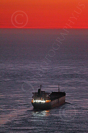 COTS 00055 An elevated starboard view of a massive civilian ocean tanker ship on the Pacific Ocean soon after sunset, by Peter J Mancus