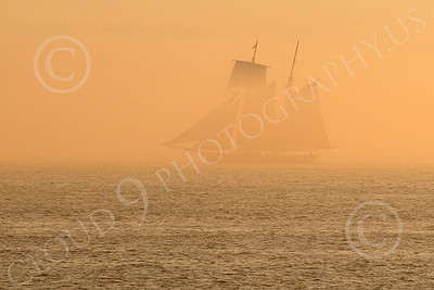 CSS 00001 A two mast civilian sailing ship sails in a golden mist in New York harbor, by John G Lomba