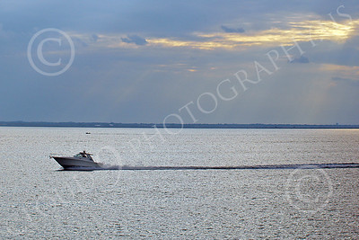 SCPB 00002 A small civilian pleasure boat speeds across a calm New York harbor with an interesting sky, by John G Lomba