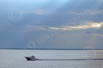 SCPB 00003 A small civilian pleasure boat speeds across a calm New York harbor with an interesting sky, by John G Lomba