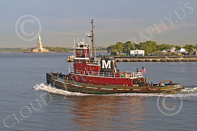 TUGB 00002 Tugboat KIMBERLY TURECAMO sails pass the Statute of Liberty in New York harbor, by John G Lomba