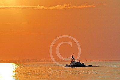 TUGB 00009 A tugboat underway in New York Harbor against a golden sunset, by John G Lomba