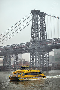 WTAXI 00002 A New York City water taxi on the East River moves under a bridge, maritime picture, by John G Lomba