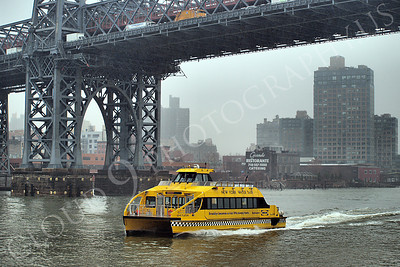 WTAXI 00001 A New York City water taxi on the East River moves under a bridge, maritime picture, by John G Lomba