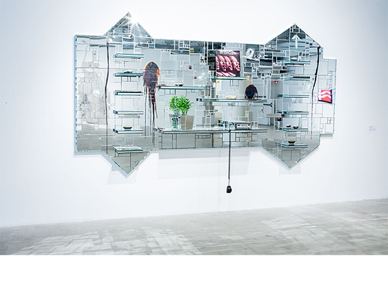 Rashid Johnson, <i>The Moment of Creation</i>, 2011, Mirrored tile, soap, vinyl, CB radio, plant, books, oyster shells, space rocks, ink jet photograph on glass. Collection of Paul and Linda Gotskind.