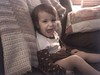 Clare Baby Legs on her arms Big Smile Couch