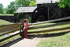 Clare Looking at the water wheel - Mabry Mill