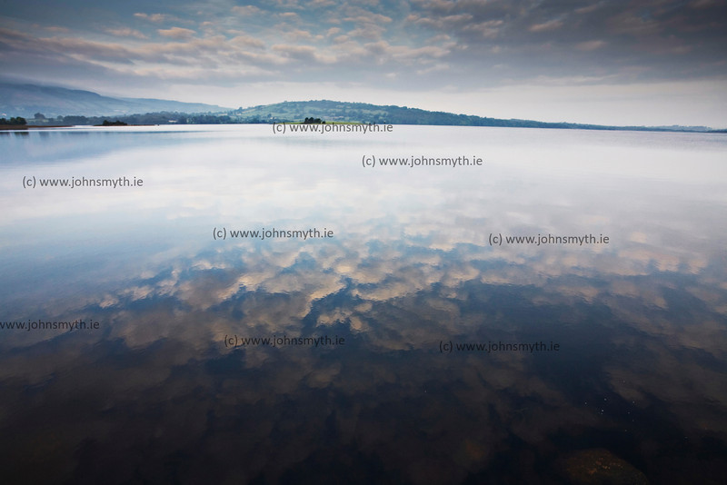 Early morning reflection in the still waters of Lough Graney in Co. Clare - taken at Flagmount vilage.