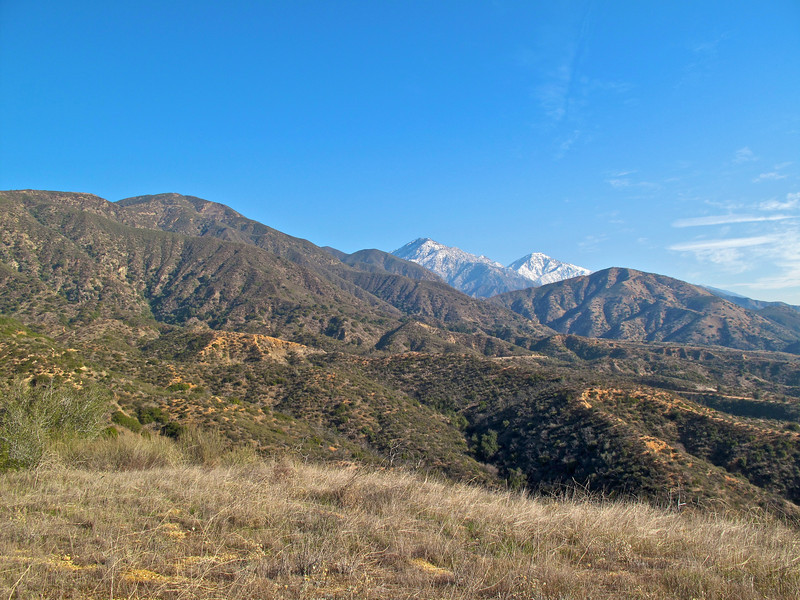 Looking east. Ontario Peak on the left, Cucamonga Peak on the right. Potato Mountain is visible.