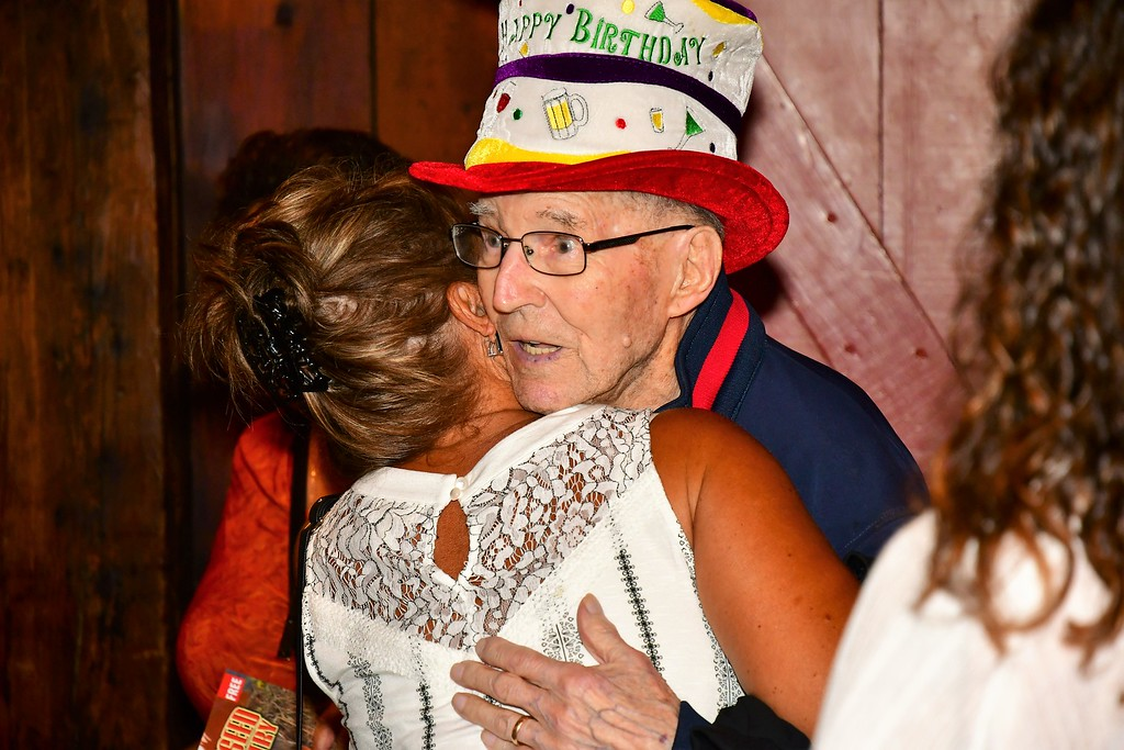 . Clarence Goguen getting a Birthday hug from daughter, Janet Benti. Sentinel & Enterprise / Jim Fay