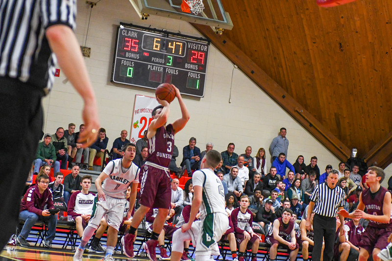 Groton-Dunstable's Tyler LeClerc fires a three-pointer in the second half. Nashoba Valley Voice/Ed Niser