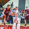 Groton-Dunstable's Gavin Keough drives the lane with the ball. Nashoba Valley Voice/Ed Niser