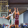 Groton-Dunstable's Tyler LeClerc shoots a three. Nashoba Valley Voice/Ed Niser