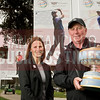 golf-Tom Clark, executive Director of World Golf Championships and Stephanie McNeill, General Manager of Championship Management at the Harding Gold course in San Francisco with the trophie.