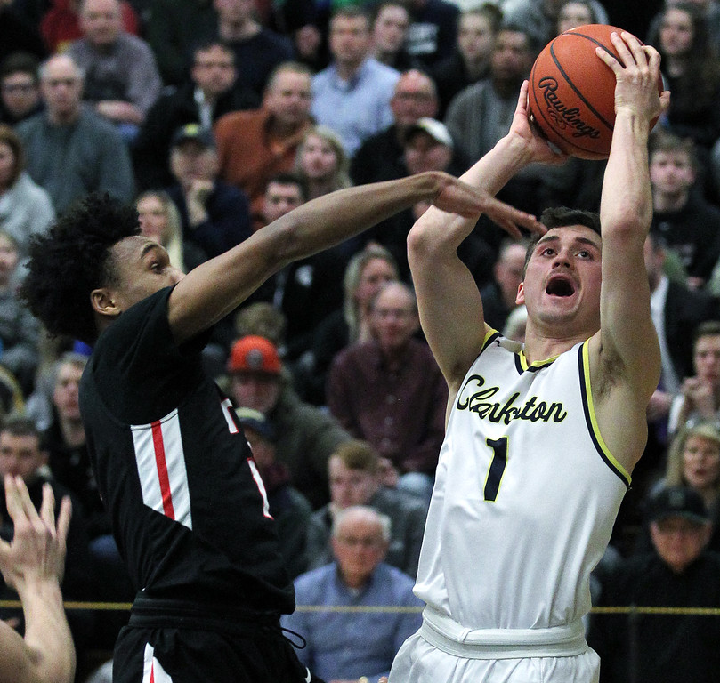 . Foster Loyer (1), Clarkston, goes up for a shot in the paint past the outstretched arm of Leon Ayers, Troy, during regional semifinal basketball action at West Bloomfield High School Monday, March 12, 2018. The Wolves dominated Troy throughout downing the Colts 71-46. (For The Oakland Press / LARRY McKEE)