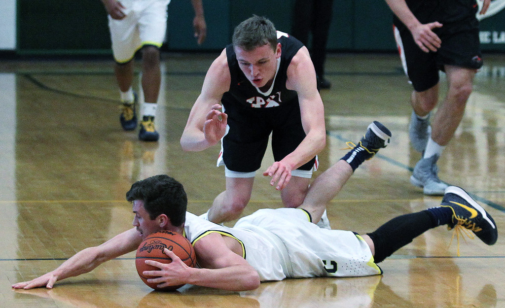 . Clarkston defeats Troy 71-46 in regional semifinal basketball action at West Bloomfield High School Monday, March 12, 2018. (For The Oakland Press / LARRY McKEE)